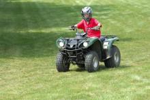 boy riding an atv